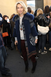 Alexandra bundles up in a fur trimmed mult-colored winter coat at the Dior fashion show in Paris.