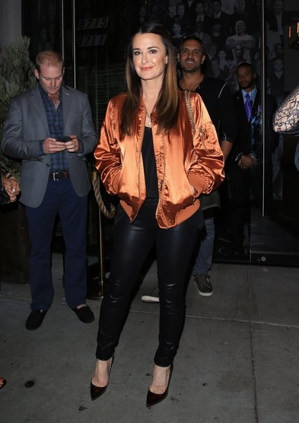 Kyle Richards was youthful and edgy in an orange bomber jacket and black leather pants while out at Catch LA.