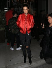 Alessandra Ambrosio was tough-chic in a red bomber jacket by Unravel while enjoying a night out at Catch LA.