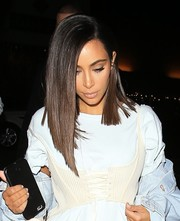 Kim Kardashian debuted a sleek asymmetrical cut while out at the Nice Guy.