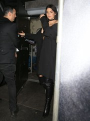 Kendall Jenner sealed off her dark ensemble with a pair of thigh-high boots by Gianvito Rossi.