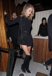 Rosie Huntington-Whiteley styled her outfit with killer black wedge boots by Prada.