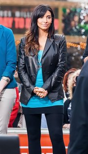Courtney Mazza showed her edgy side with a cool leather jacket with eyelet sleeves.