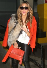 Nicole Scherzinger glammed it up with a fur scarf while visiting the SiriusXM Radio Studios.