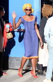 Lupita Nyong'o left 'Good Morning America' wearing a figure-flaunting periwinkle dress with colorful trim along the neckline and hem.