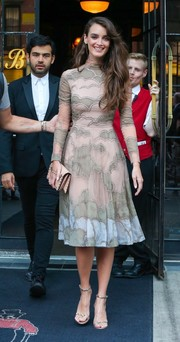 Charlotte Le Bon paired her lovely dress with studded gold heels.