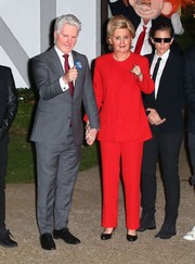 Katy Perry's Hillary-in-a-red-suit costume during Kate Hudson's Halloween party was a clever campaign gimmick!