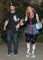 Leslie Mann completed her costume with a plaid mini skirt and a pair of roller skates.