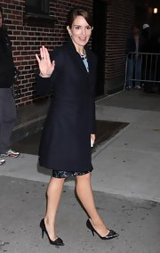 Because her dress is modern with polka-dots, Tina is wearing a textured black leather heel. Very Cute!
