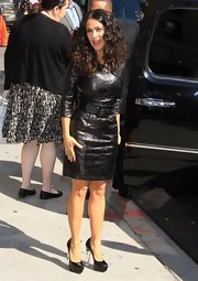 Salma went for the ultimate vixen look with this crushed pleather dress.