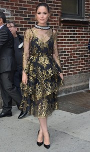 Rose Byrne looked breathtaking in this Huishan Zhang confection, featuring tiered gold lace with a black underlay, as she arrived for her 'Late Show with Stephen Colbert' appearance.
