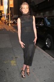 Taylor Schilling made an alluring choice with this sheer black turtleneck dress for her 'Stephen Colbert' appearance.