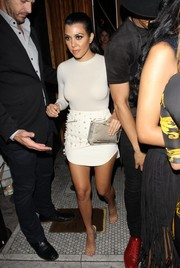 Kourtney Kardashian completed her outfit with the shoe of the moment: the Yeezy Season 2 lucite-heel sandal.