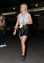 Julianne Hough chose a scalloped black leather mini skirt for her cool concert ensemble.