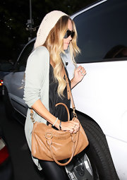 Lauren Conrad added a subtle touch to her relaxed look with a tan leather shoulder bag.