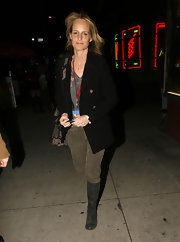 Helen Hunt kept her look low key with sage green knee high boots.