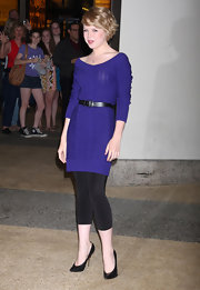 Sofia looked royal in a purple ribbed sweater dress. Black leggings and matching heels complete the casual chic look.