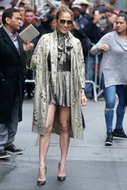 Jennifer Lopez paired her coat with a metallic mini dress by Misha Collection.