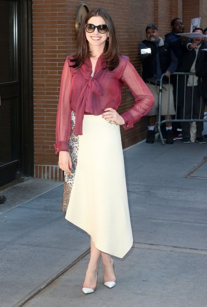 Anne Hathaway chose an asymmetrical, partially printed skirt by Stella McCartney to complete her outfit.