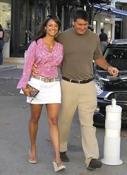 Eva la Rue showed off her laid-back style with a pink print blouse and a white mini skirt while out and about in Monaco.