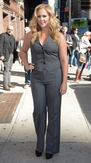 Amy Schumer stepped out in New York City looking masculine-chic in this matching gray vest and trousers combo.