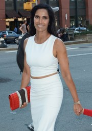 Padma Lakshmi was spotted out in New York City carrying a chic red leather clutch with black-and-white snakeskin detailing.