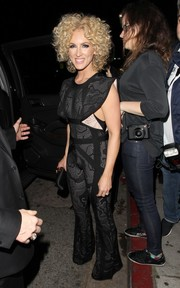 Kimberly Schlapman headed to a Grammy after-party looking '70s-chic in a flared lace jumpsuit.