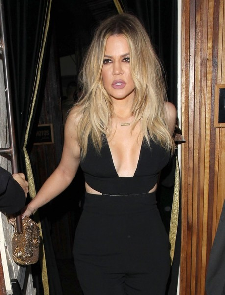 Khloe Kardashian headed to a Grammy after-party carrying a glamorous beaded clutch by Chanel.