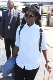 Lupita Nyong'o kept a low profile at the Ronald Reagan Washington National Airport with a pair of round sunnies and a black hat.