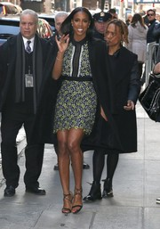 Kelly Rowland layered a black wool coat over her dress for a bit of warmth.