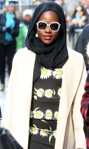 Lupita Nyong'o was spotted outside the 'Good Morning America' studio looking mysterious in white-rimmed shades and a black head scarf.
