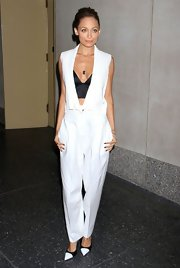 Nicole Richie opted for a super sleek look when she wore this menswear-inspired white jumpsuit with a peek-a-boo black bustier.