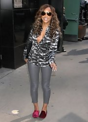 Eve chose a gray and black camo-style silk button down for her look at the 'Good Morning America' studios.