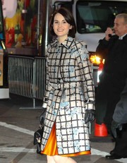 Michelle Dockery stayed warm with a pair of black leather gloves while headed to 'Good Morning America.'