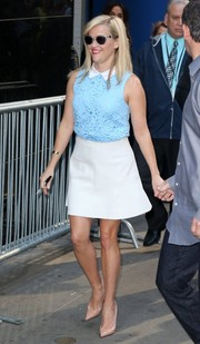 Reese Witherspoon played up her youthful looks in a collared blue lace blouse for her 'Good Morning America' appearance.