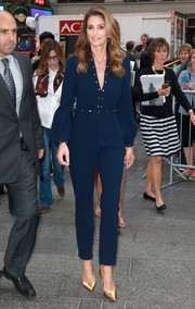 Cindy Crawford went for casual sophistication in a studded blue jumpsuit by Zimmermann during her 'Good Morning America' appearance.
