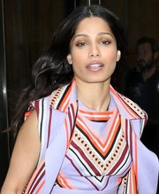 Freida Pinto looked lovely with her flowing center-parted waves while visiting SiriusXM.