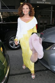 Diane von Furstenberg headed to the Met Gala wearing a yellow lace gown with white ruffle detailing.