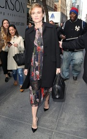 Diane Kruger added some warmth with a classic black wool coat.