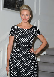 Cameron Diaz wore glossy black nail polish at the Christian Dior fashion show in Paris.