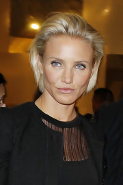 Cameron Diaz wore her short choppy bob swept back at the Versace fashion show in Paris.