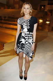 Diane Kruger paired her black and white print dress with patent leather pumps.