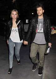 Ashley Benson kept her street style grungy with a pair of acid-washed skinny jeans and a leather jacket.