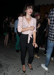 Milla Jovovich was spotted out at the Nice Guy sporting a cute lip-print blouse.