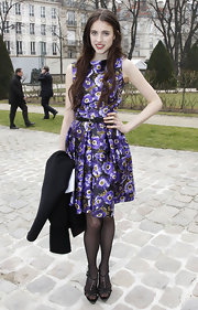 Sarah Margaret Qualley was looking prim, proper and pretty in this purple boat-neck day dress.