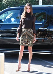 Alessandra Ambrosio traded in her usual sexy outfits for this conservative brown Emilio Pucci turtleneck for her appearance on 'Extra.'