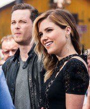 Sophia Bush accessorized with a swirly pair of H. Stern dangling diamond earrings for her appearance on 'Extra.'