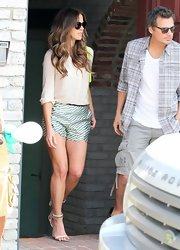 Kate Beckinsale dressed up her daytime look with a pair of satin striped shorts.