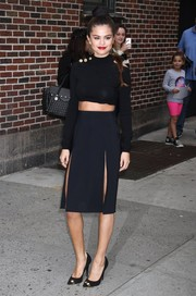 Selena Gomez turned heads in a black skirt with double slits teamed with a crop top, both by Versus, as she arrived for her appearance on 'Letterman.'
