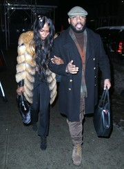 Naomi Campbell paired her coat with simple black slacks.